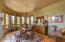 The formal dining room with a curved wall of windows and views.