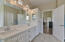 Master bath with quartz counters and new designer light fixtures.