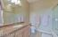 Granite topped vanity and full bathroom.