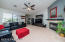 Spacious living room includes a cozy gas fireplace.