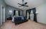 Large master bedroom with vaulted ceilings with access to the Arizona room.