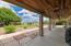 Extended Covered patio with fans and added wood ceiling.