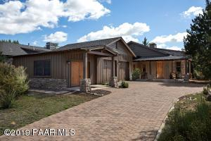 Paver Driveway; 3 Bays in the Garage; one can be a Workshop or Office.