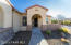 with Spanish Arch Entry, Stacked Stone Accents, Open Coffee Patio & Security Screen Door.