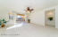 has Lighted Ceiling Fan w/Remote Control, Glass Tiled Fireplace, Media Niche, Large Sunny Sliding Door & Accent Windows, Horizontal Blinds & Sheer Drapes, Carpet Flooring and Brand New Paint.