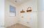 with Side Window, Utility Sink Pre-Plumb, Utility Closet, Laundry Shelf & Tile Flooring.