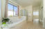 with Marble Surround Deep Oval Soaking Bath, Glass Enclosed Shower, Sunny Side Window with Privacy Drapes, Sliding Door Linen Closet, Executive Height Marble Counter with Dual Sinks, Private Toilet Rm w/Window, Tile Flooring & Walk In Closet.