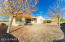 Nice and Open Rear Yard with Block Wall Fencing, Covered Rear Patio, Mature Shade Trees, Easy Care Desert Rock Landscaping with Drip Watering System, Mountain & Park Views.