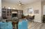 Formal Living Room with Plank Tiled Flooring, Lighted Ceiling Fan, 2 Tone Designer Paint, Sunny Windows with Plantation Shutters & Beautiful Built in Cabinetry.