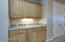 Granite Butlers Pantry with Hardwood Cabinetry, Under Cabinet Lighting + Dual Slide Out Shelves.