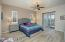 Spacious Master Suite with Sliding Door to Covered Rear Patio & Yard, Pleated Black-out Shades, Ceiling Fan, Accent Windows with Plantation Blinds, 2 Tone Paint & Plank Tile Flooring.