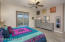 Spacious Master Suite with Panoramic Views, Nice Sliding Door to Covered Rear Patio & Yard, Pleated Black-out Shades, Ceiling Fan, Accent Windows with Plantation Blinds, 2 Tone Paint & Plank Tile Flooring.