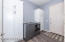 Large laundry room with lots of storage space.