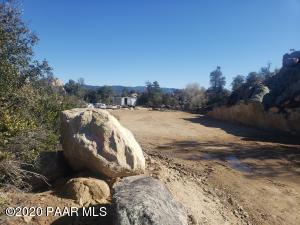 FLAG LOT WITH LOTS OF BOULDERS.NEW 15 LOT PHASE IN THIS HIGHLY SOUGHT AFTER PRESCOTT SUBDIVISION. LESS THAN 2 MILES FROM HISTORIC DOWNTOWN PRESCOTT. GORGEOUS VIEWS OF THUMB BUTTE & GRANITE MOUNTAIN AMAZING VIEWS OF DOWNTOWN PRESCOTT. BOULDERS, NATURAL LANDSCAPING,LARGE LEVEL ENGINEERED BUILDING PAD. CITY WATER, CITY SEWER, NATURAL GAS, NO HOA!! 2000 SQ FT MIN CHOOSE YOUR BUILDER NO BUILD TIME. SEE ATTACHED PUBLIC REPORT, PLAT, AND CC&R'S