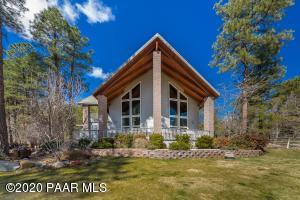Proud front on this dramatic 2 acre horse property in the pines...