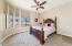 This bedroom features a large closet and jack n jill bathroom