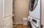 Main Floor Laundry Room with Large Closet. Front Load Washer & Dryer are Included with the Sale.