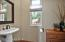 Handsome guest bathroom with additional built in storage