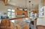 Outstanding kitchen with soft close cabinets, full slab granite, and open to the great room for entertaining.