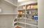 Large walk in pantry for all of your food storage needs.