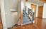 Graceful stairs to lower level walkout and bonus loft space