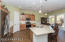 Even a large walk in corner pantry in this super kitchen