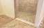 With Roll-in Shower & Double Vanities Adjacent to Walk-in Closet