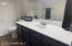 Large Full Bath for the Guest Bathroom with wood plank tile floors.