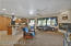 Spacious great room with fire place and open to the kitchen for entertaining