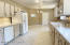 Lower Level Kitchenette and Dining Area. All appliances convey.