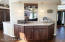 Situated off the Kitchen and open to Great Room is the Wet Bar area.