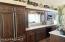 """Spacious Kitchen with """"garden window"""" at sink overlooks the side yard."""