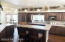Kitchen with Center Island and raised bar area.