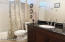 Tub Shower Combo and vanity with Marble Top.