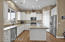 Kitchen with matte granite counters, upgraded cabinets with soft close doors & drawers