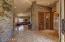 Custom rock-clad walls, stone floors & open views grab immediate attention.
