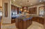 Wolf Appliances, Granite Counters, beautiful Custom Cabinets, & a designer Backsplash in this Gourmet Kitchen.