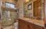 A 3/4 en suite Bathroom with marvelous Granite & lots of counter space.