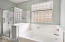 includes Garden Tub and Glass Enclosed Shower