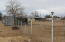 Another area with shelter for cows or horses plus storage unit on side