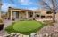 Covered Back Patio, Putting Green, Flagstone Patio and Mature Trees