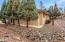 Ample room in the back yard to add more entertaining space and backs to a 2.5 acre parcel for added privacy.