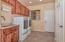 Large laundry room with wash sink and storage. The washer and dryer convey.
