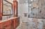 Fully remodeled master bathroom with large walk in shower and custom cabinetry.