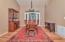 Large dining room with adjoining bonus room.