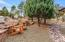 Enjoy your outdoor space with 8 Ponderosa Pines and boulders on your property.