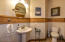 Powder room with wood floor