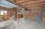4 Car garage interior showing vintage shiplap wood