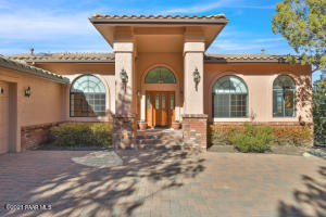 Front entry and paver driveway with turn-a-round