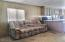 Livingroom with pull out couches and recliners.